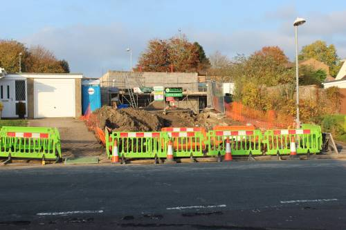 Electricity supplier digging up the pavement