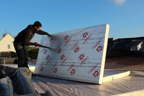 100mm Celotex insulation being cut to fit