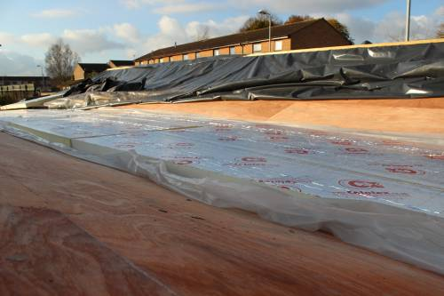 Insulation expanding over the 'flat' roof section
