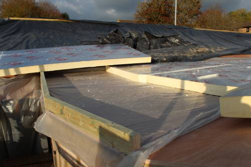 Timber edging holding the insulation in place