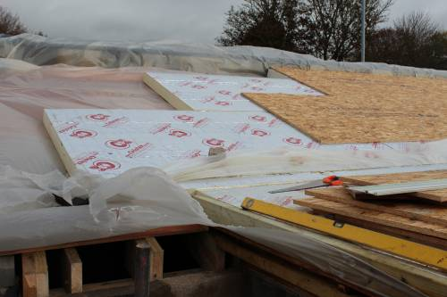 All the layers - ply, vapour barrier, insulation, OSB (Oriented Strand Board)