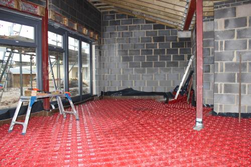 Underfloor heating trays across the living room