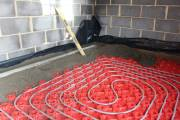 Screed poured right over the heating pipes