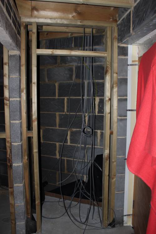 Electric cabling leading to the consumer unit in the cupboard