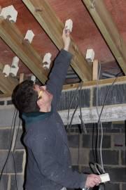 Sliding insulation blocks over each screw to prevent heat loss