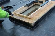 Applying plenty of glue to the timber upstand.
