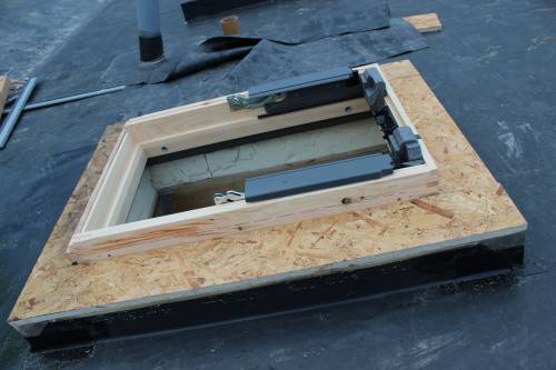 The mounted window chassis. Roof construction layers visible.