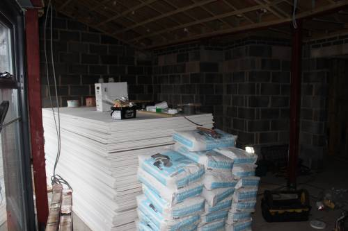 Mountain of plasterboard and plasterboard adhesive