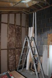 Partition wall cavities getting filled with insulation