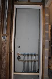 The airing cupboard, showing off underfloor heating manifold