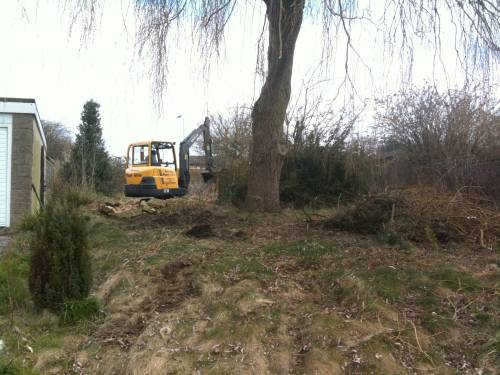 Mini digger on site