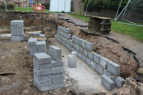 The retaining wall will hold up the footpath