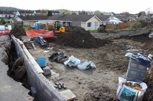 Our retaining wall and what's left of the footpath