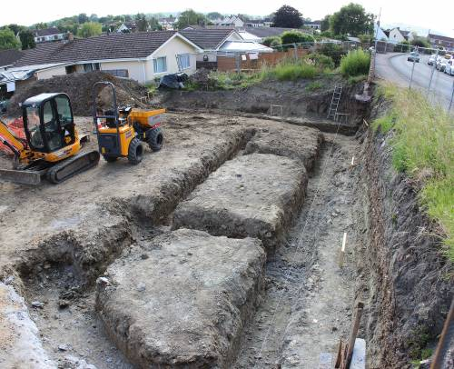 Foundation trenches viewed from public footpath above