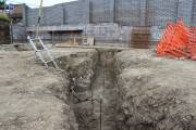 Foundation trench with height marker for concrete pour
