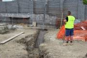 First load of concrete goes into the trenches