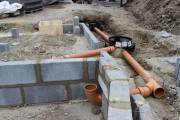 The pipes will a few inches below ground (probably patio slabs)