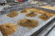 Sand waiting to be spread and compacted on the ballast