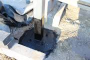 Bolted to the foundation using four bolts and resin adhesive