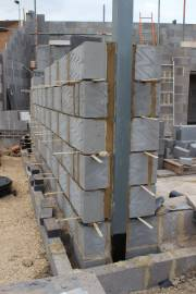 Steel columns being encased within the cavity walls