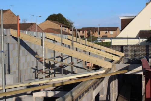 The first trusses go into place on the first day's work