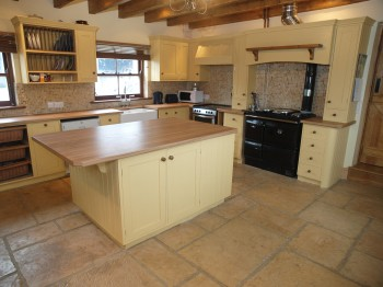 Period property style stone kitchen flooring in a new home