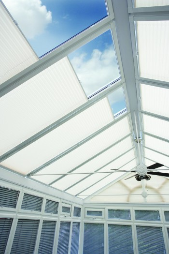 Sliding conservatory roof blinds