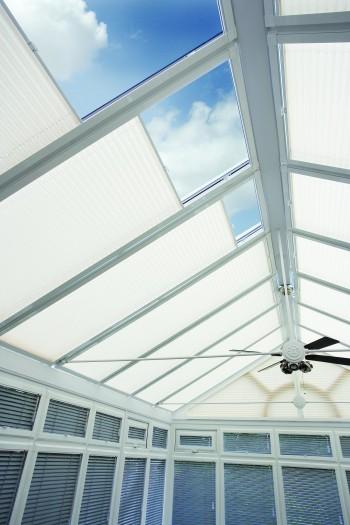 Sliding conservatory roof blinds
